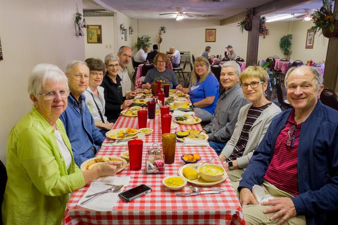 The service-learning tour group enjoyed lots of delicious food over the course of the tour, including chicken and dumplings, fried catfish, and collard greens. (Left to right) Mary and Merlin Grieser, Carol Sandbakken, Erika and Barry Kreider, Arloa Bontrager, Susan Nisly, Gerald Fryenberger, and Cathy and Steve Schmid.