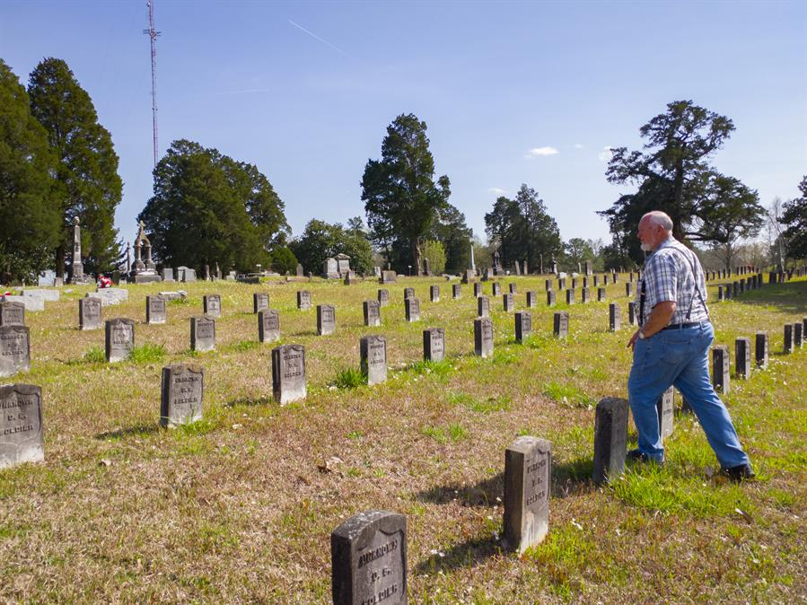 Larry Miller, with Mennonite Service Center in Mashulaville, led daily tours around historical Civil Rights sites with the service-learning tour group, including the Odd Fellows Cemetery in Macon, Mississippi.