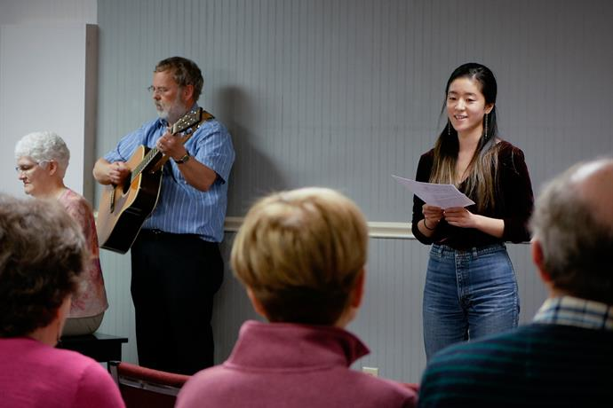 Risa Fukaya, a participant with the Jackson, Mississippi Service Adventure unit, sings a solo at Open Door Mennonite Church while unit leaders Cynthia and Roger Neufeld Smith play accompaniment.
